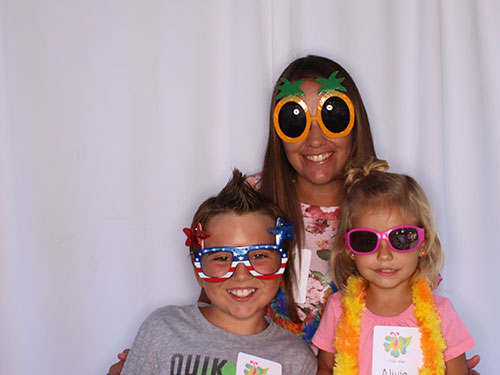 3 children at Stormberg Orthodontics Appreciation Day 2017 smiling with sunglasses